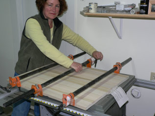 Gluing the wood panels into a board