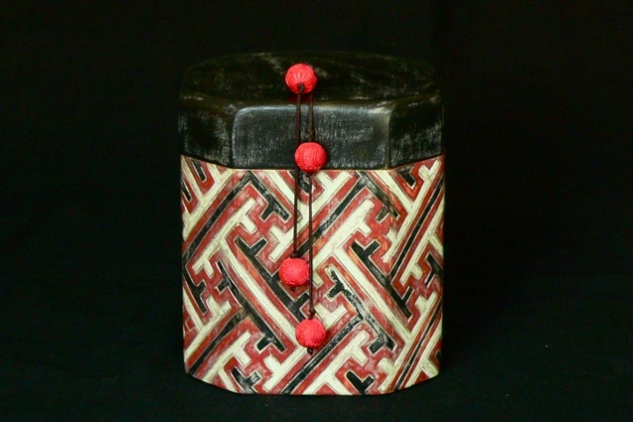 Red and black Chinese brocade box. Dimensions 8'' x 5.5'' x 5.5''